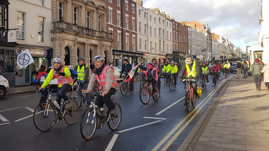 Extinction Rebellion activists jump in the saddle
